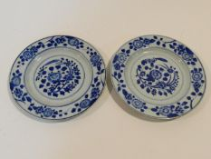 Two 18th century Chinese porcelain export ware plates with stylised floral design within a floral