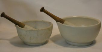 A large 19th century apothecary's ceramic mortar and pestle and another similar, stamped Made in