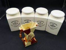 A set of four Swan & Taylor ceramic kitchen storage jars and a hand painted Myott & Son ceramic
