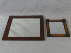 An early 19th century mahogany pier mirror with pilasters to each side and an Edwardian mahogany and