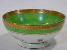 An antique Irish Arklow hand painted porcelain bowl with floral design, apple green band with gilt