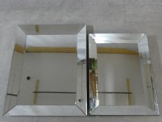 An Art Deco style wall mirror in glazed frame and a similar mirror. 94x75cm (largest)