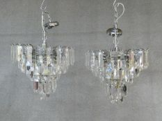 A pair of ceiling chandeliers with clear perspex lozenge form drops. H.60 D.40cm