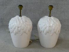 A pair of glazed table lamps of bulbous form with leaf decoration. H.50xD.26cm