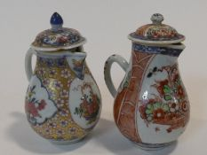 Two 18th century hand painted Chinese porcelain export ware tea pots. One with a gilt floral