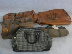 A miscellaneous collection of five various vintage holdalls, to include a leather gladstone bag,