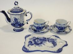A Russian Gzhel blue and white glazed ceramic two person coffee set with hand painted floral