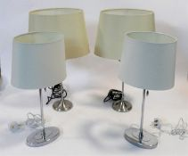 A pair of contemporary table lamps and their shades and a similar pair. H.59cm