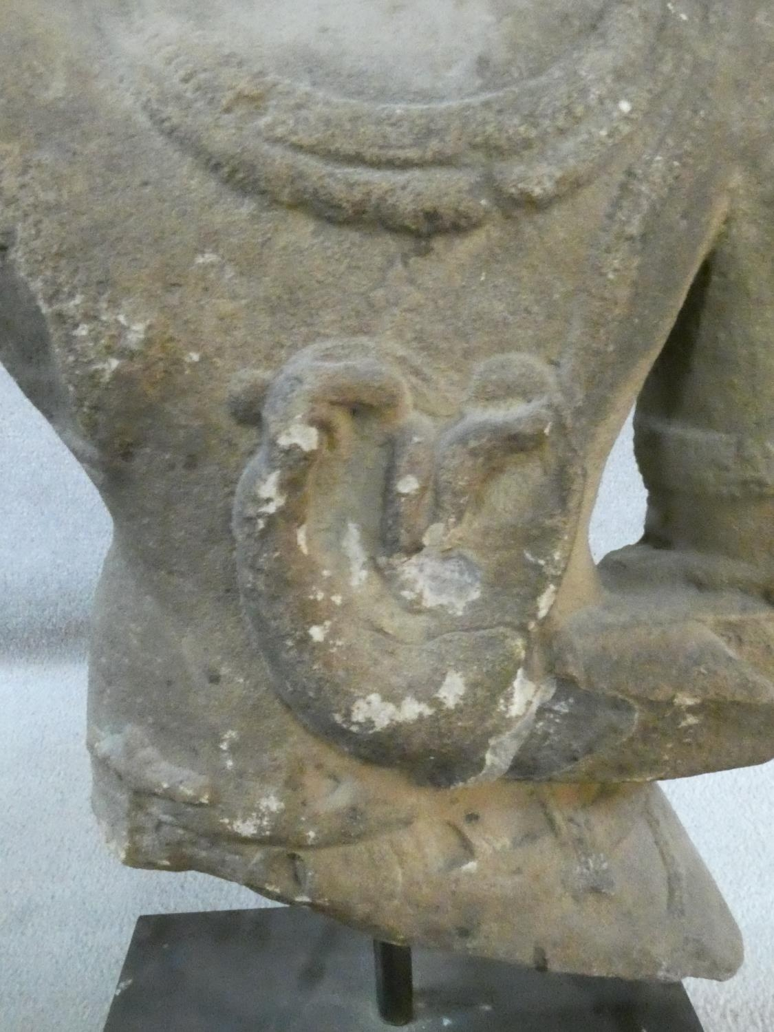 A 14th/15th century South East Asian carved sandstone figure of a deity mounted on a square - Image 3 of 5