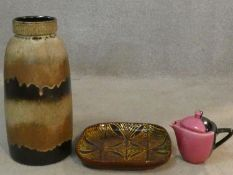 A collection of three ceramic items. Including a large West German glazed ceramic vase. with
