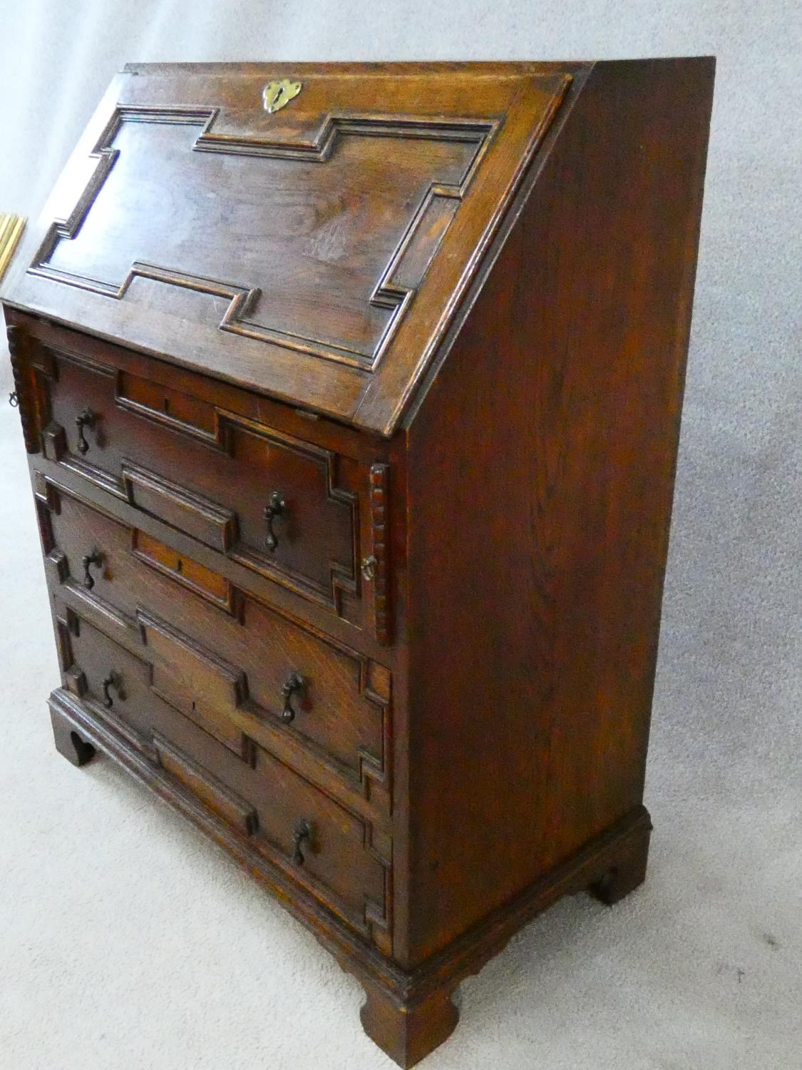 A mid century Jacobean style oak bureau with lozenge inset panels and fall front revealing fitted - Image 14 of 26