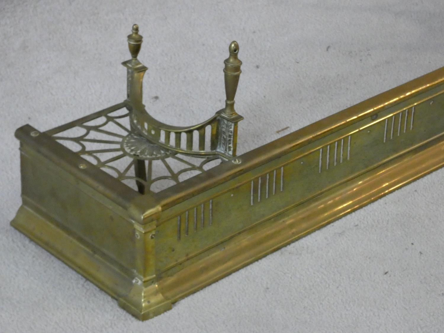 A 19th century pierced brass fender with kettle stand to each end. H.32 W.127 D.29cm - Image 3 of 5