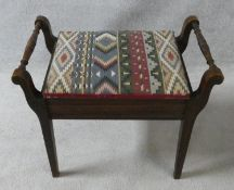 A late 19th century mahogany piano stool on square tapering supports. H.51XL.58XW.35