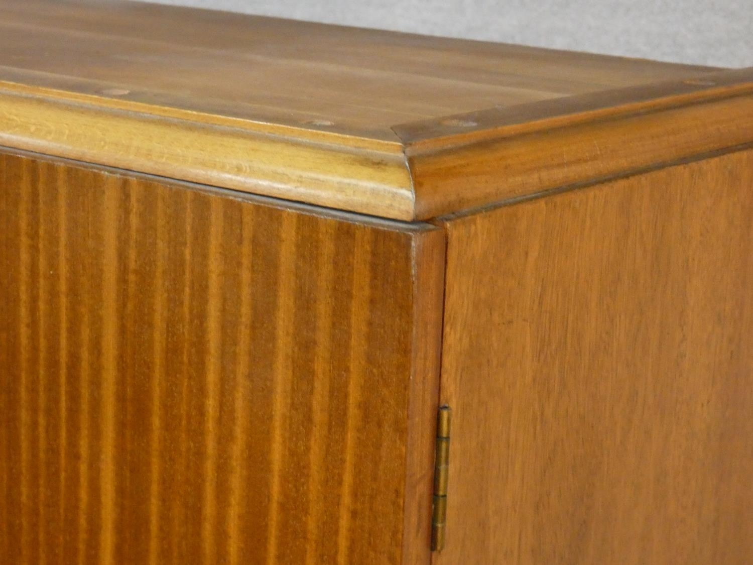 A 1960's teak wardrobe fitted with shelf and hanging space with inset Heal's disc to the inside of - Image 4 of 6
