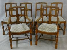 A set of six of mid century oak Jacobean style armchairs with drop in seats on turned baluster