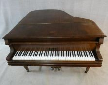A 'Lestel' of London mahogany cased boudoir baby grand piano, metal framed, raised on square
