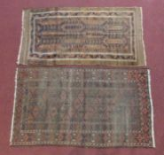 An Eastern rug with pale burgundy ground and another similar. H.162xW.91cm