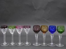 Eight antique Bohemian cut to clear sherry/cordial glasses. A set of four with vine design and
