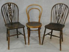A pair of Windsor wheelback dining chairs and a vintage bentwood cafe chair. H.93cm