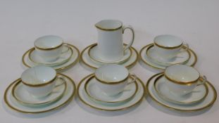 A Hammersly & Co gilded porcelain part five person coffee set. Decorated with a black and gold