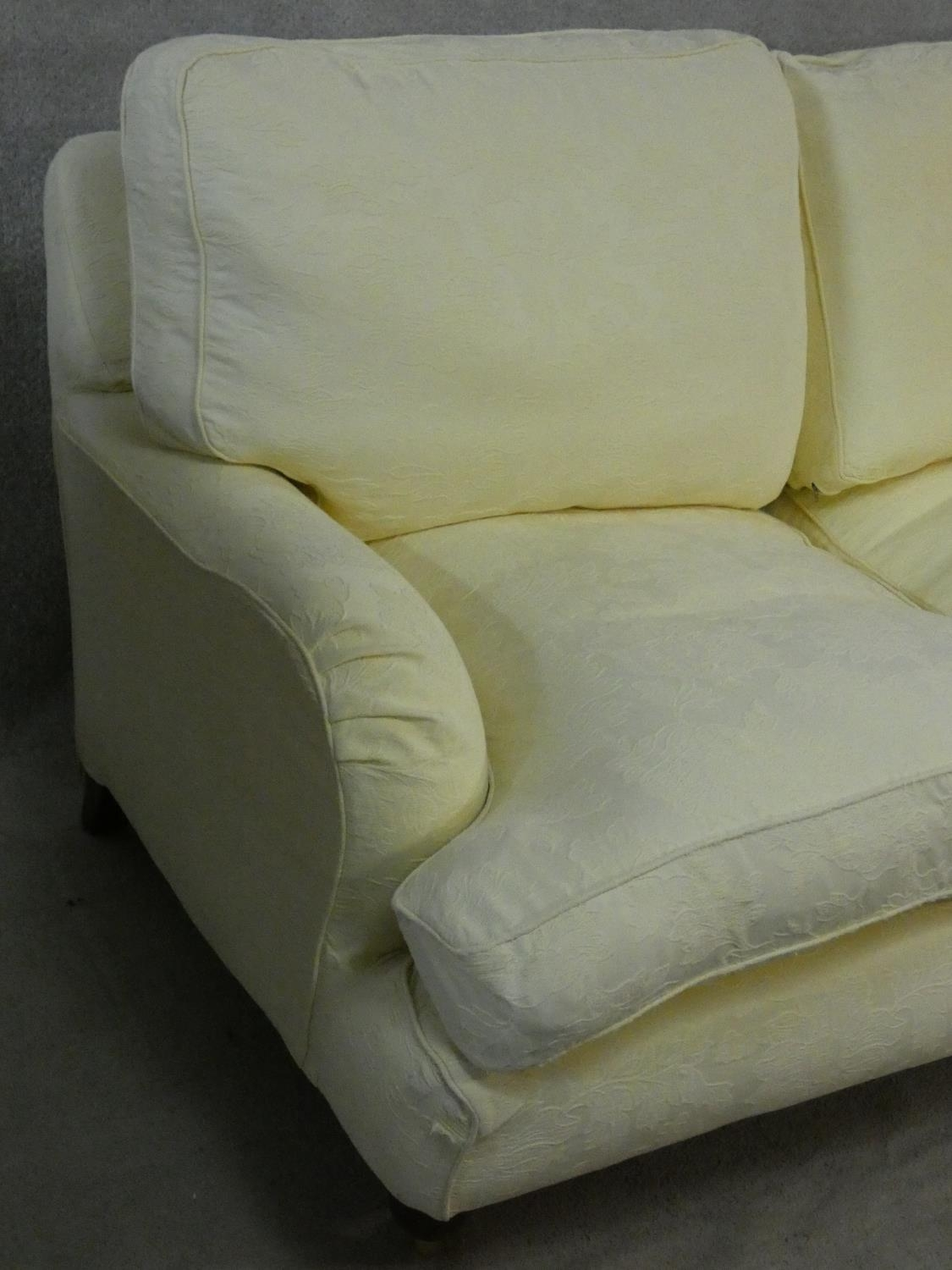 A Multiyork Howard style two seater sofa in jacquard upholstery on turned tapering supports on brass - Image 4 of 12