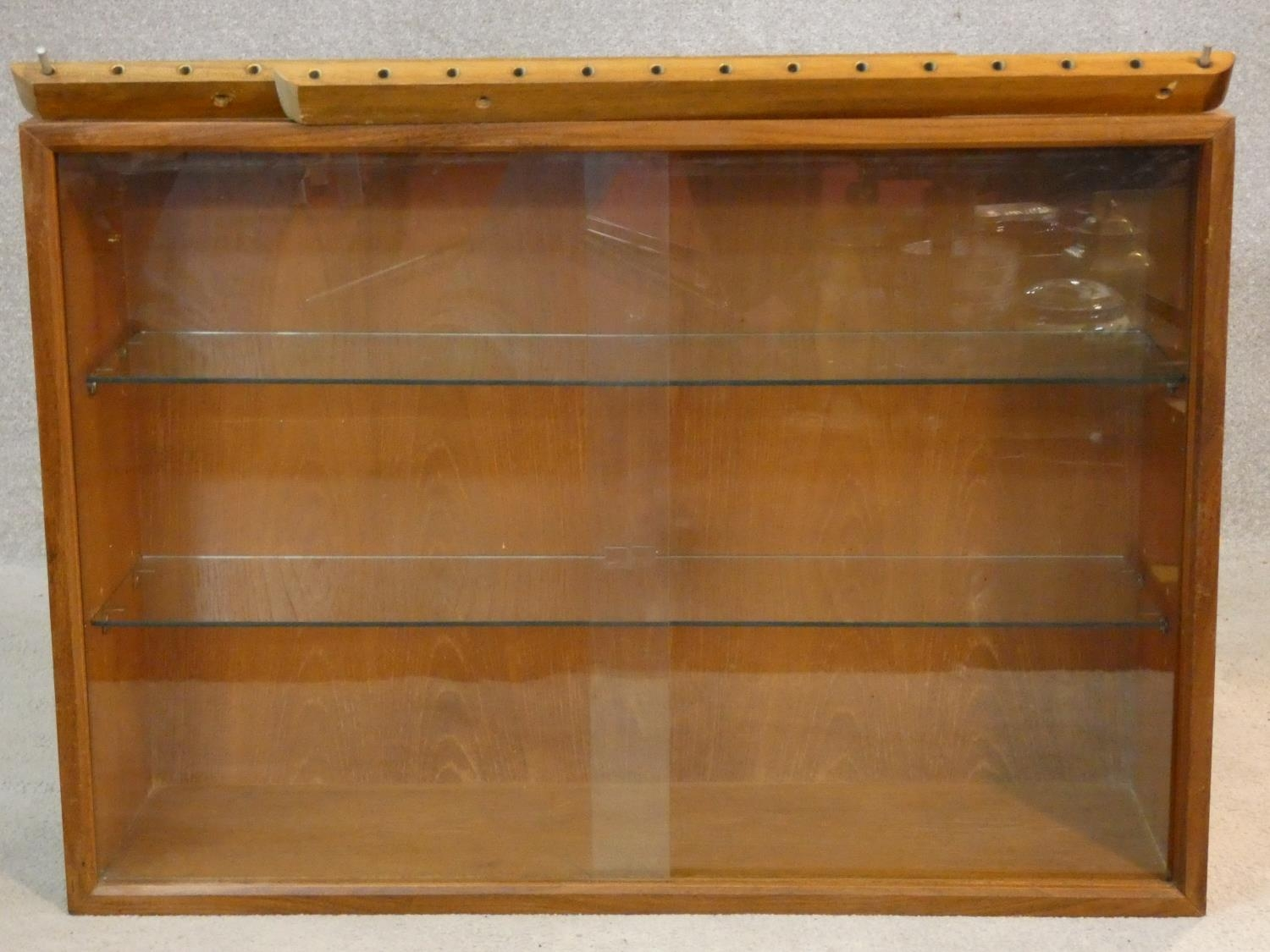 A 1960's vintage teak wall hanging cabinet with fittings. H.56 W.80 D.24cm