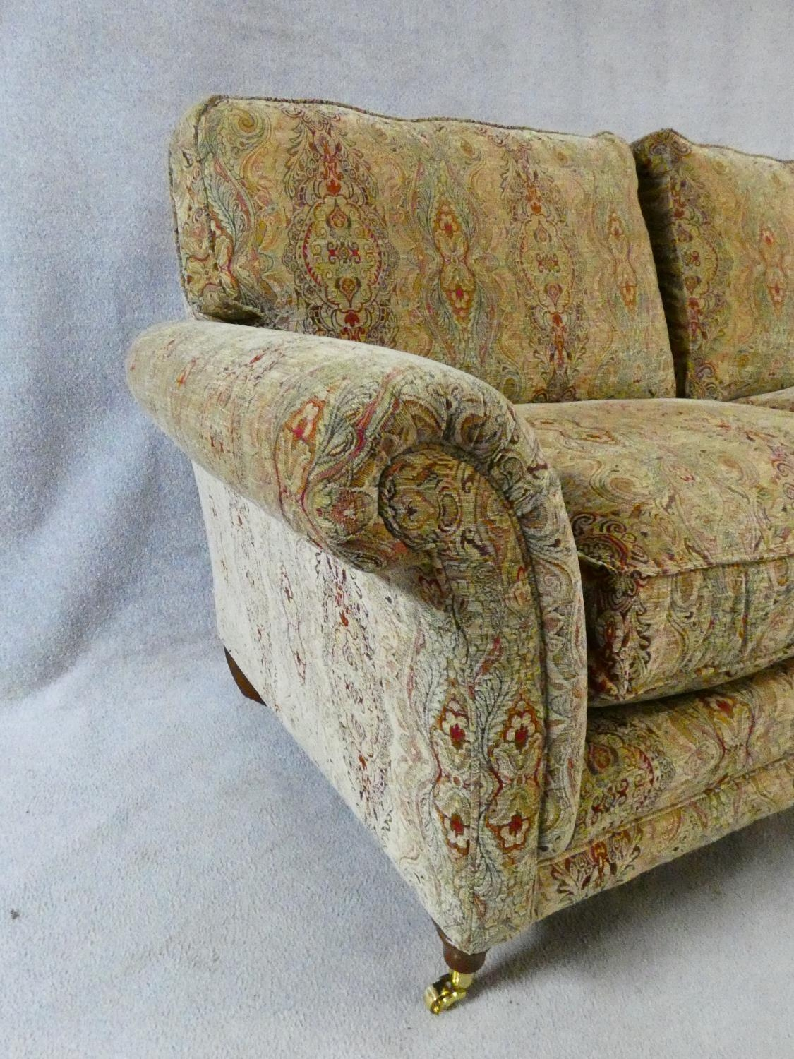 A large Parker Knoll two seater Burghley sofa in Baslow Medalli gold upholstery raised on turned - Image 6 of 10