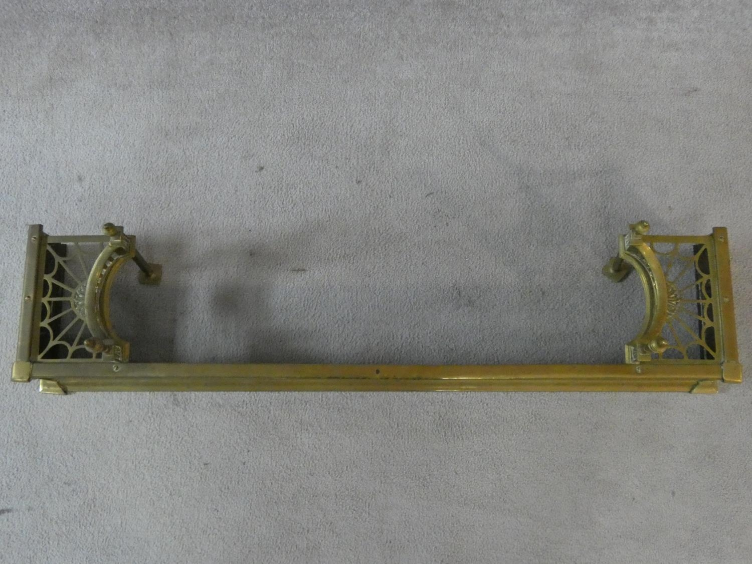 A 19th century pierced brass fender with kettle stand to each end. H.32 W.127 D.29cm - Image 2 of 5