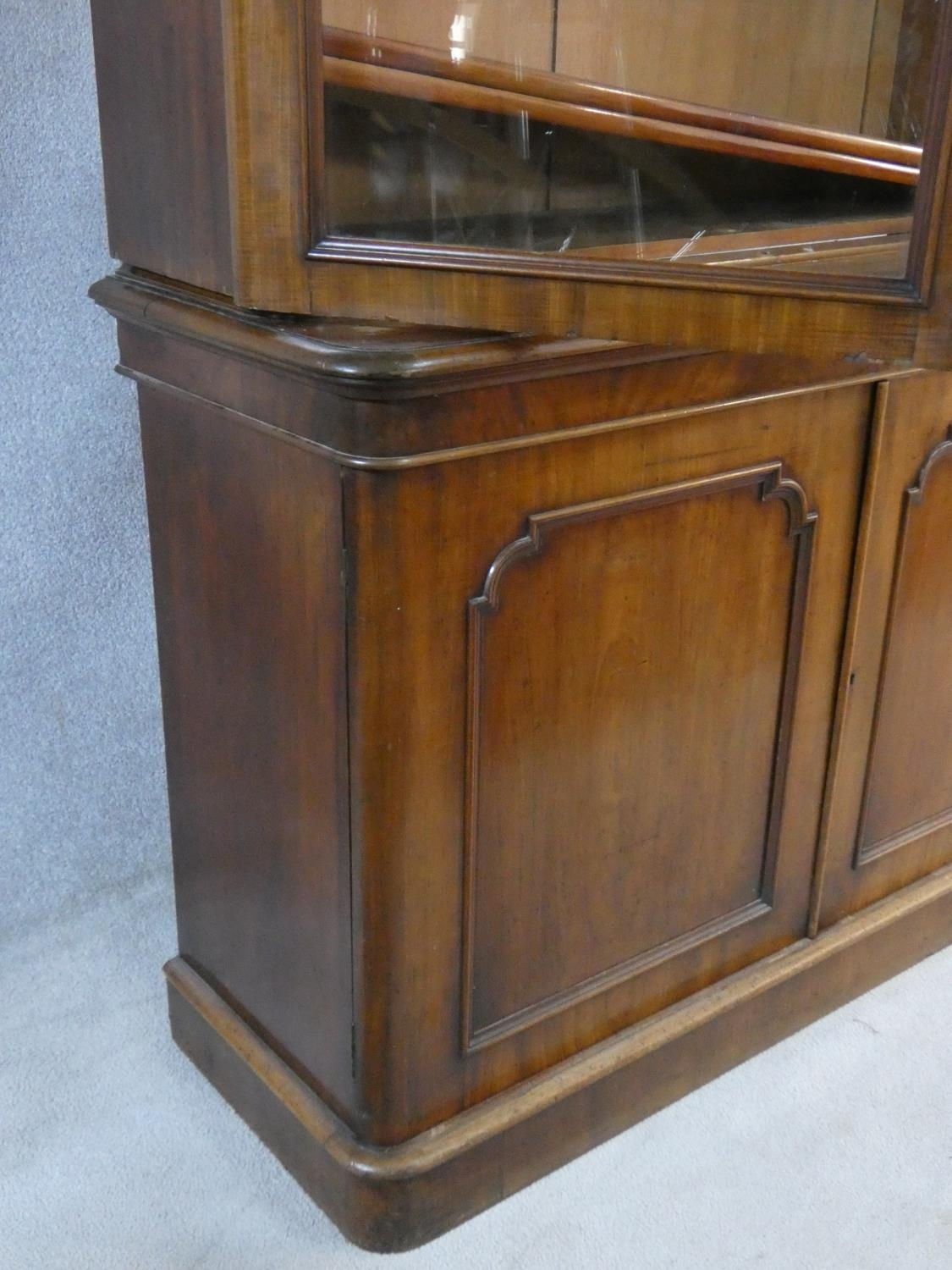 A Victorian mahogany library bookcase with upper glazed doors enclosing book shelves above base - Image 4 of 5