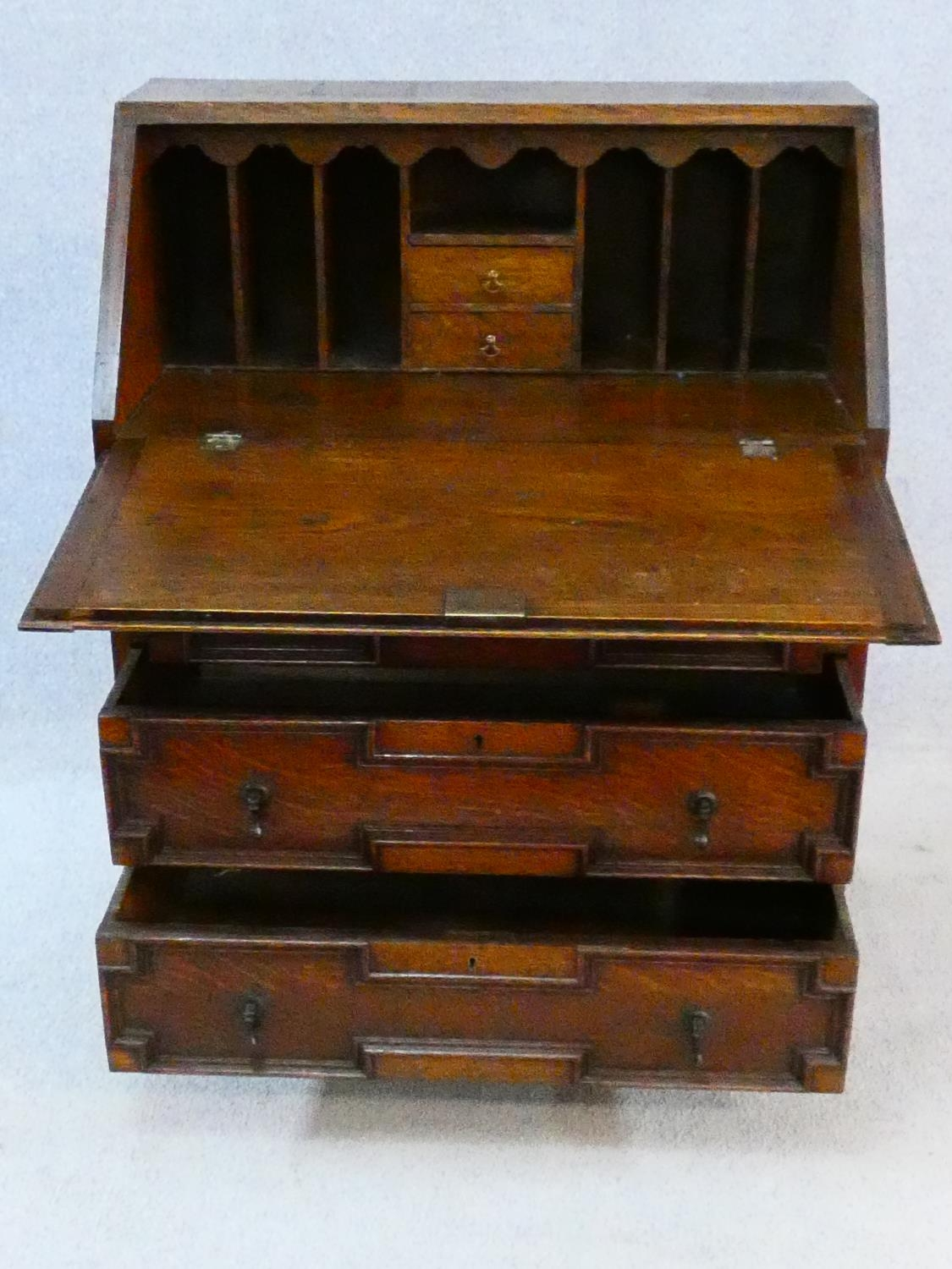 A mid century Jacobean style oak bureau with lozenge inset panels and fall front revealing fitted - Image 3 of 26