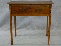 A 19th century pine side table with frieze drawer on square supports. H.73 W.76 D.45cm