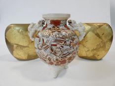 A vintage Satsuma ware lamp base with hand painted Japanese warriors and Foo dog handles, along