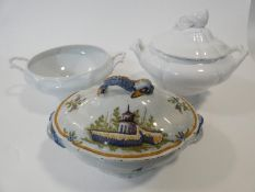 Three ceramic soup tureens. One hand painted French Faience tureen painted with buildings and