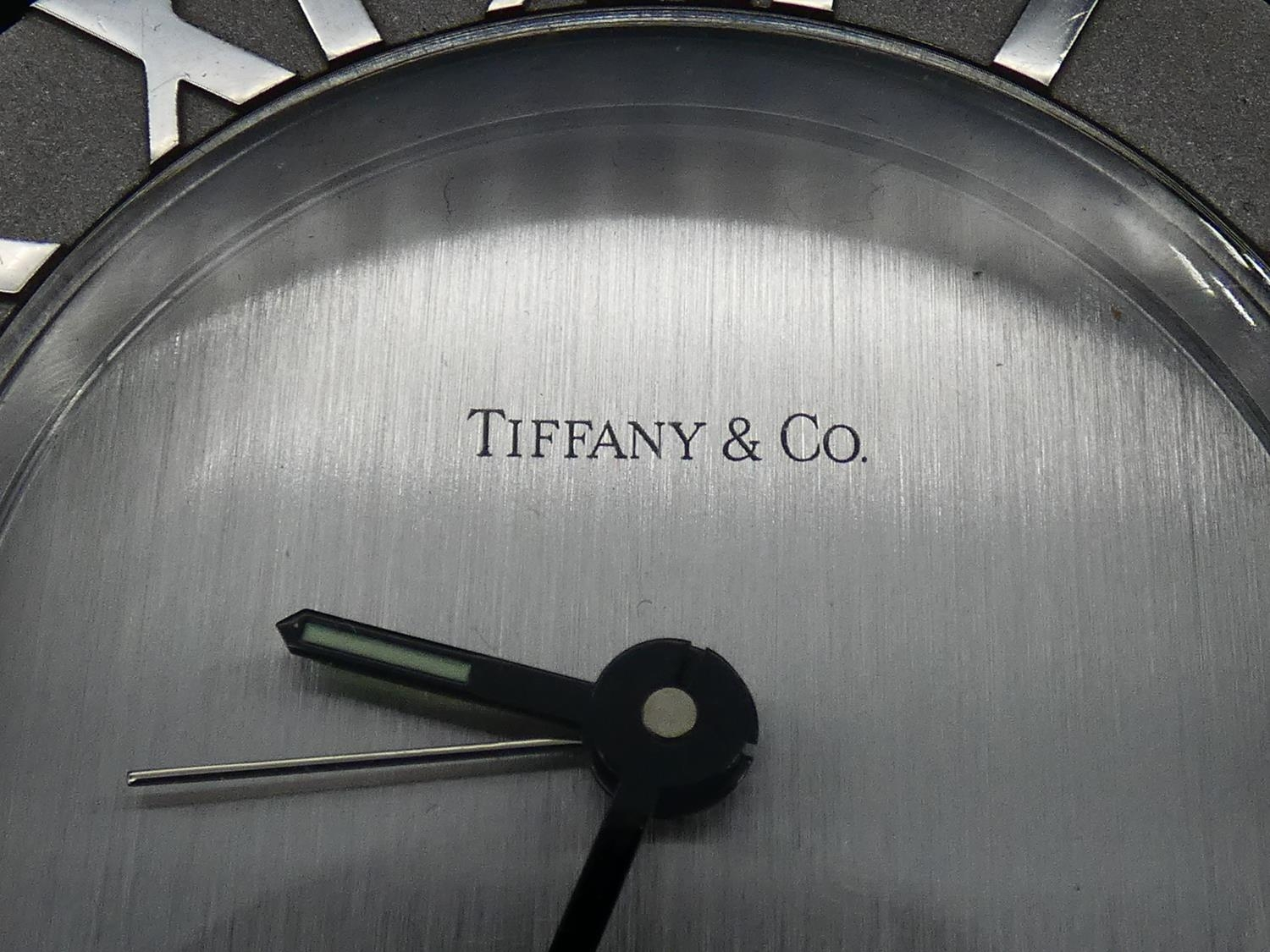 A Tiffany & Co Swiss made stainless steel Roman numeral quartz alarm clock with brushed chrome bezel - Image 2 of 6