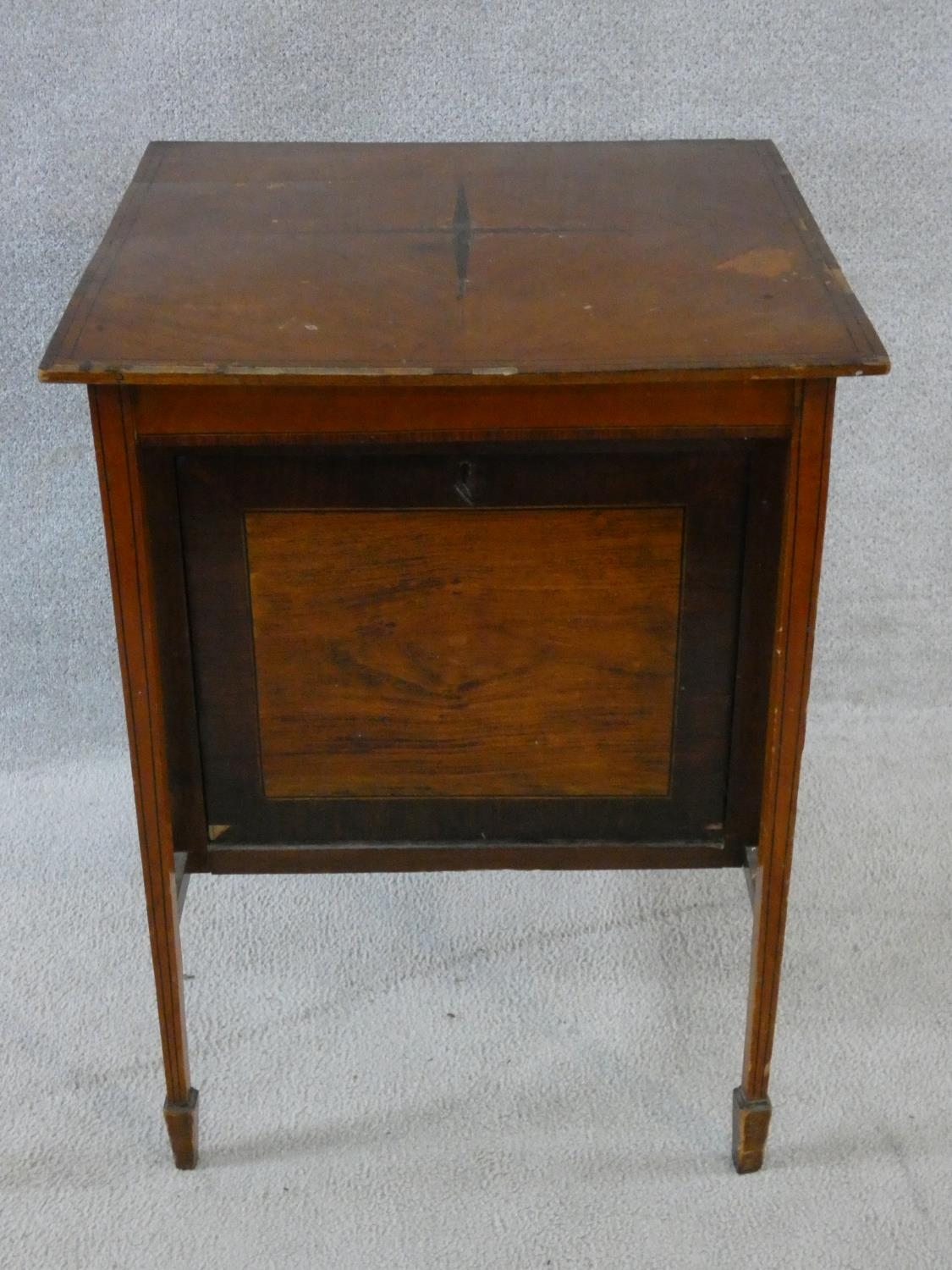An Edwardian fitted mahogany record cabinet. H.70 W.52 D.52cm