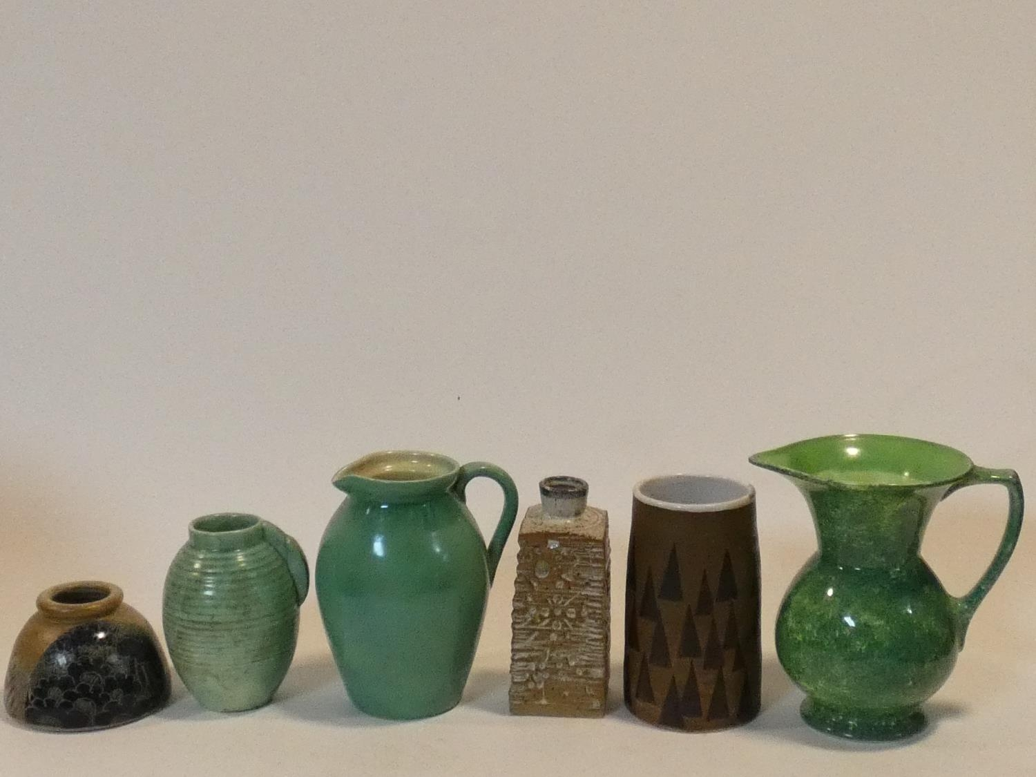 A miscellaneous collection of various Art Pottery jugs and vases. H.20cm (tallest)