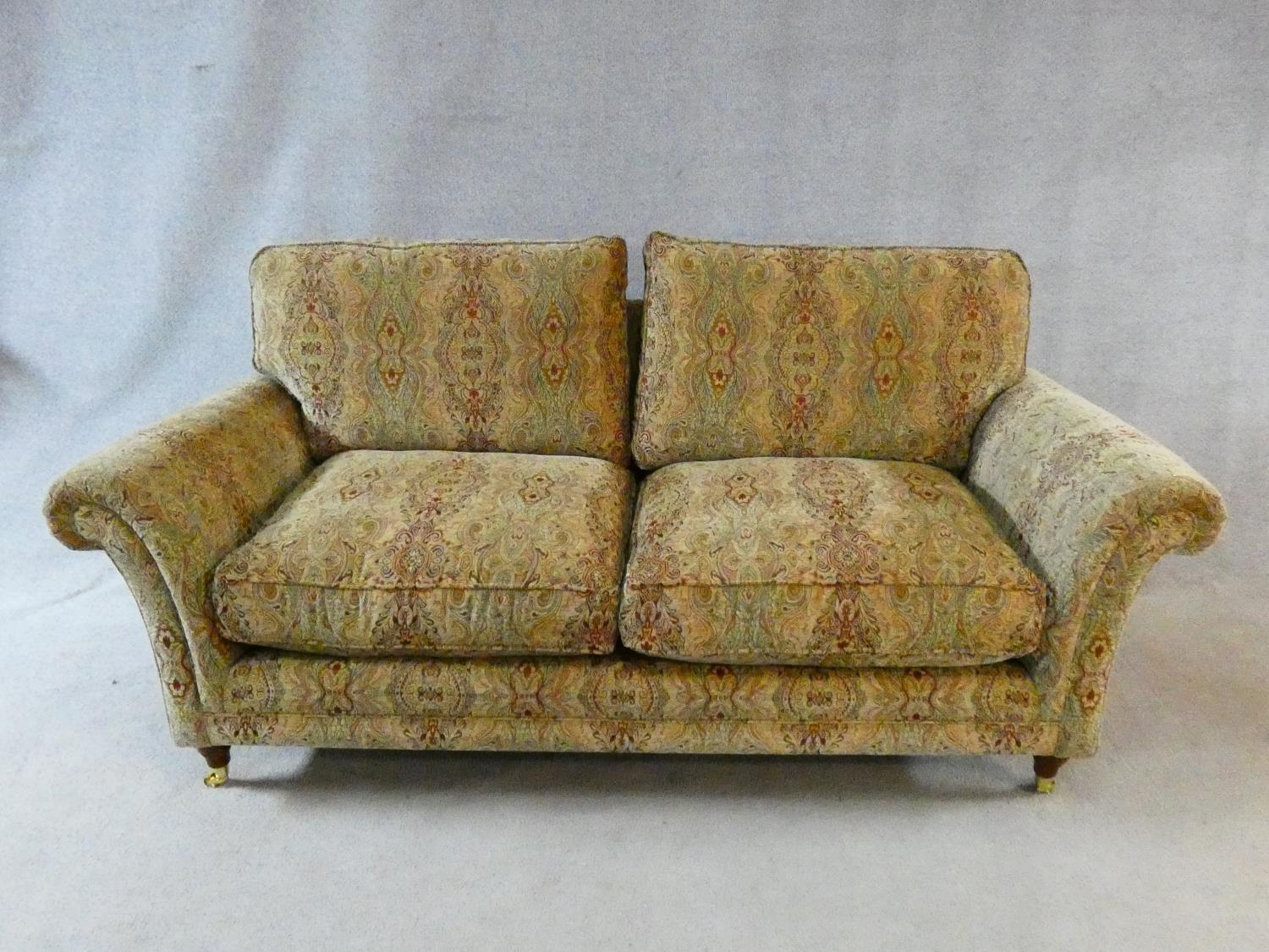 A large Parker Knoll two seater Burghley sofa in Baslow Medalli gold upholstery raised on turned - Image 2 of 10