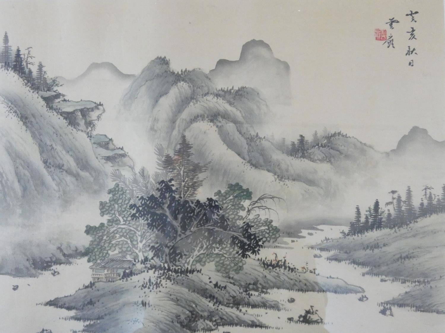 A framed and glazed ink on silk, Japanese mountainscape, stamped. 43x50cm