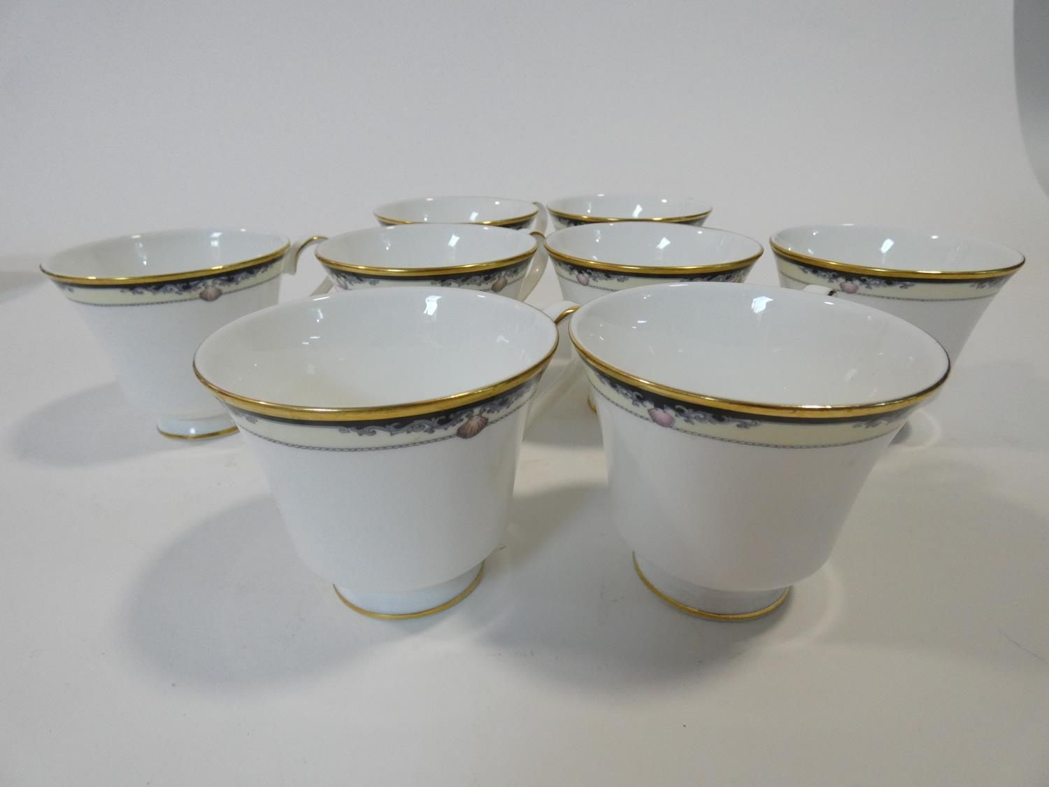 A Royal Doulton Rhodes design tea and coffee set to include cups, saucers and milk jugs. H.17cm - Image 19 of 34