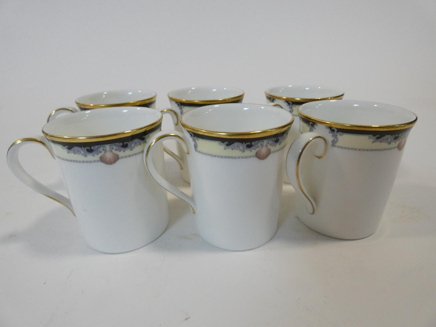 A Royal Doulton Rhodes design tea and coffee set to include cups, saucers and milk jugs. H.17cm - Image 12 of 34