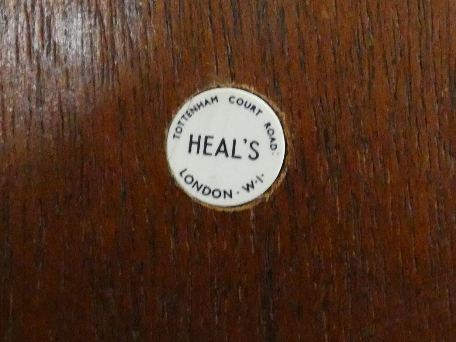 A 1960's teak wardrobe fitted with shelf and hanging space with inset Heal's disc to the inside of - Image 6 of 6
