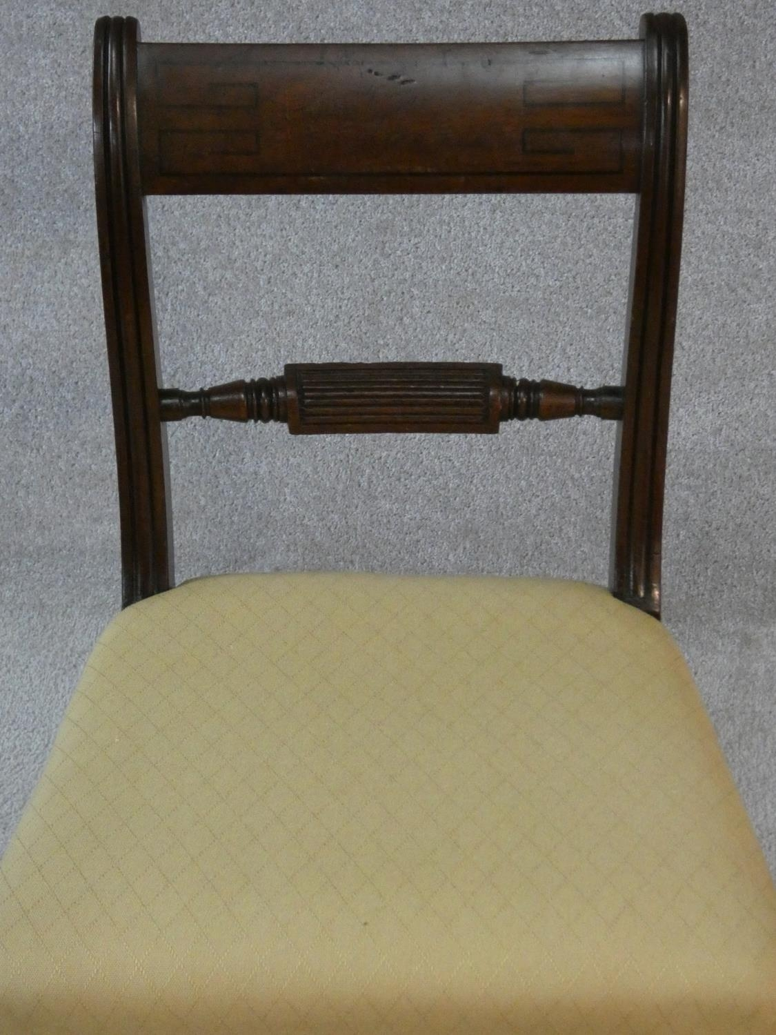 A set of four late Georgian mahogany bar back dining chairs with ebony Greek key pattern inlay above - Image 5 of 7