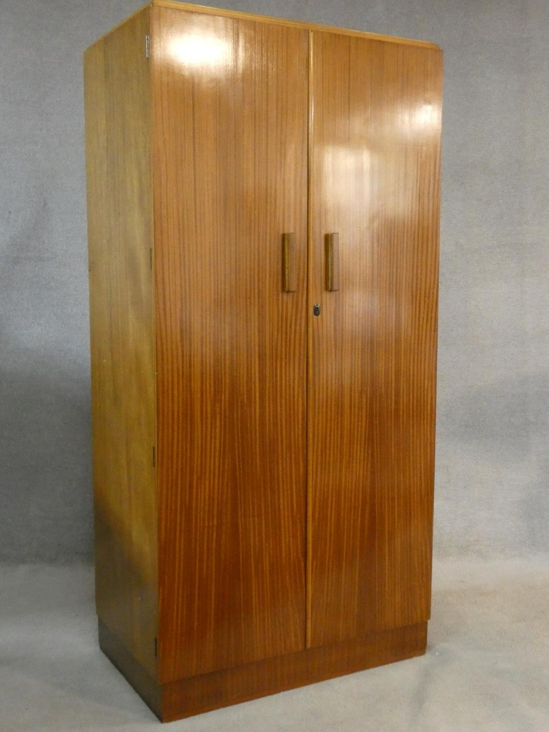 A 1960's teak wardrobe fitted with shelf and hanging space with inset Heal's disc to the inside of - Image 2 of 6