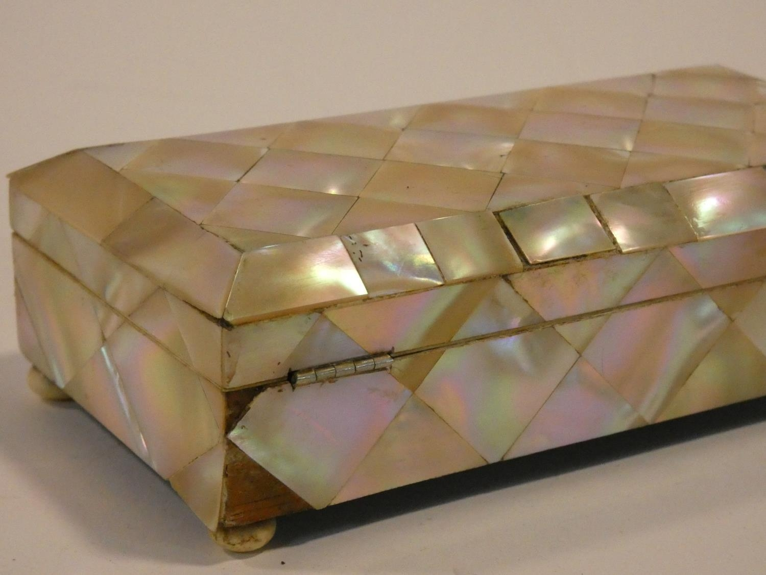 A 19th century parquetry inlaid mother of pearl jewellery casket on ivory bun feet. Missing key. H. - Image 4 of 5