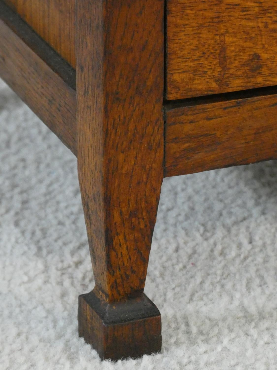 An early 20th century country oak style side cabinet with carved panel doors on squat square - Image 10 of 14