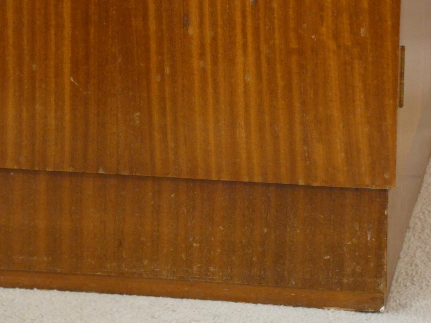 A 1960's teak wardrobe fitted with shelf and hanging space with inset Heal's disc to the inside of - Image 5 of 6