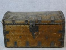 A 19th century iron bound domed top travelling trunk in deer skin hide covering. H.38 W.66 D.39cm