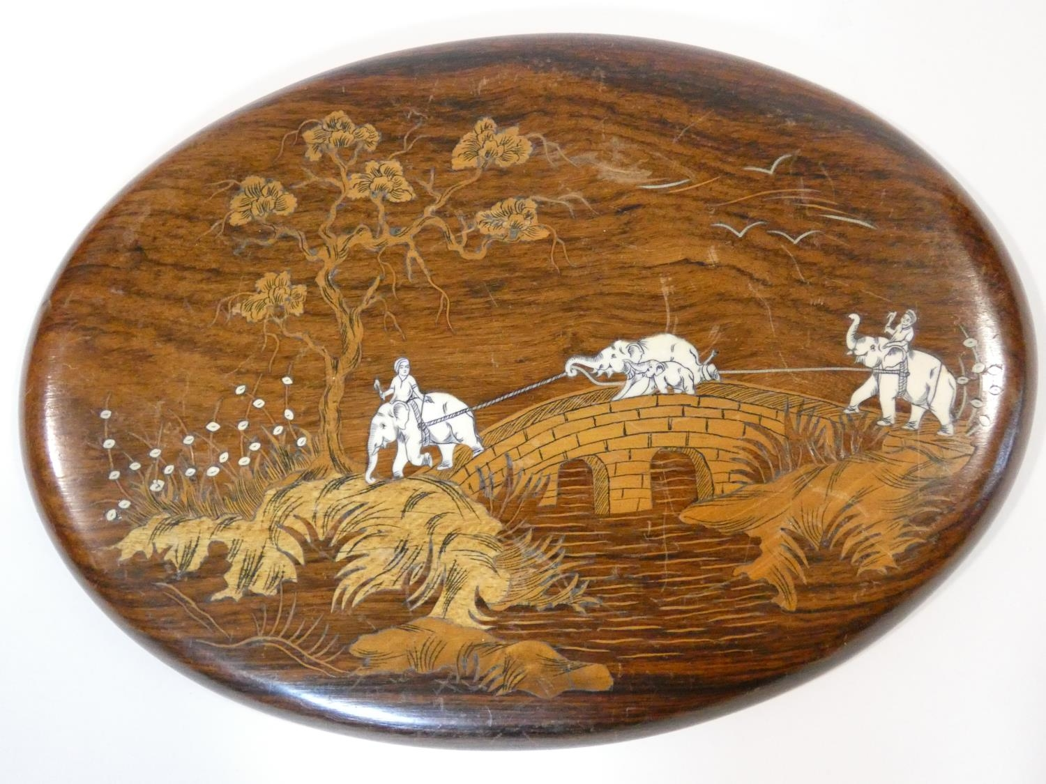 A hardwood inlaid Indian wall plaque with a procession of elephants on a bridge, green glazed - Image 6 of 9