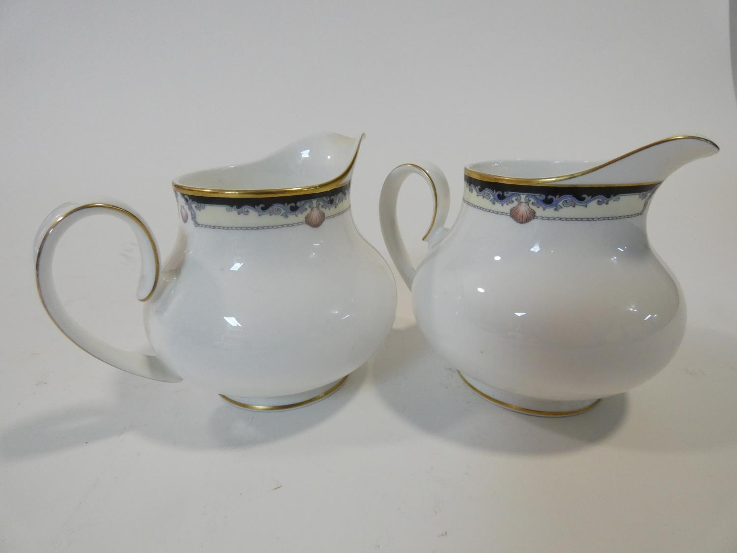 A Royal Doulton Rhodes design tea and coffee set to include cups, saucers and milk jugs. H.17cm - Image 34 of 34