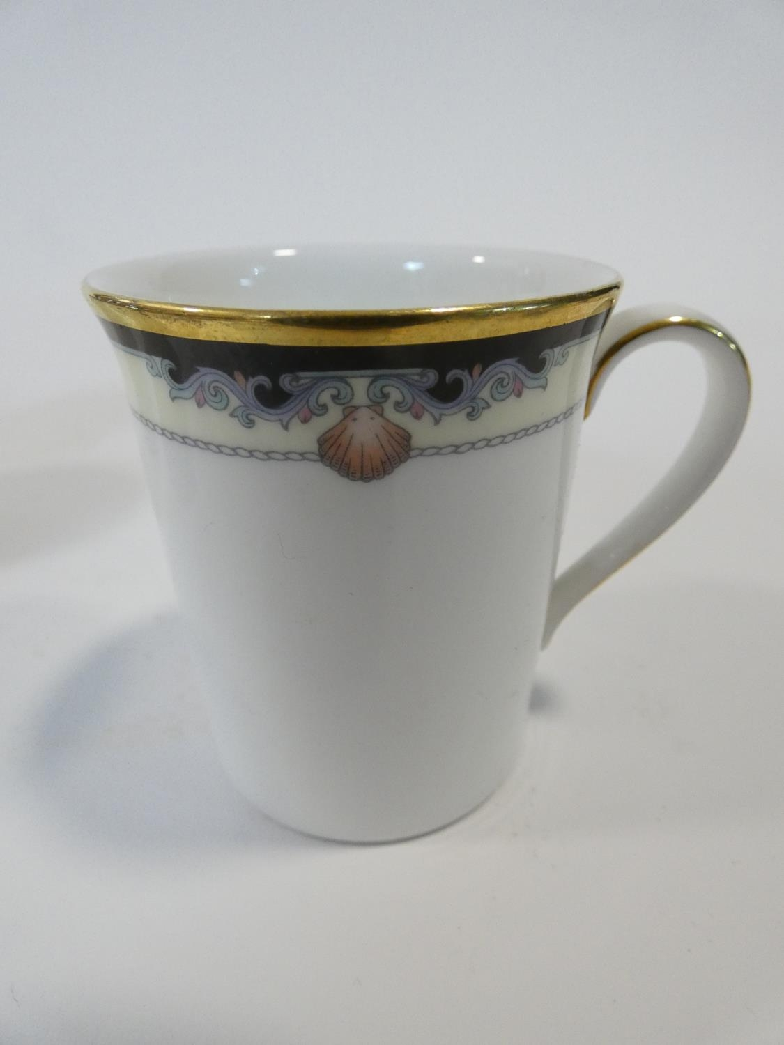 A Royal Doulton Rhodes design tea and coffee set to include cups, saucers and milk jugs. H.17cm - Image 13 of 34